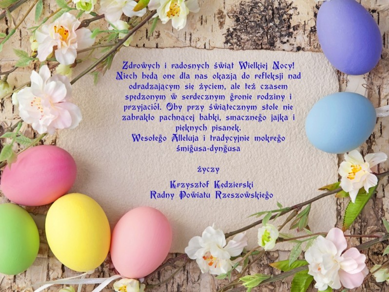 Easter eggs and blank note on wooden background